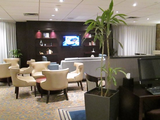 Dorval, Canada: Tables & couches at the VIP Club Lounge