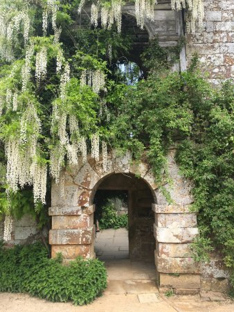 Lamberhurst, UK: View of the castle, wisteria in full bloom and lovely seat with magnificent views