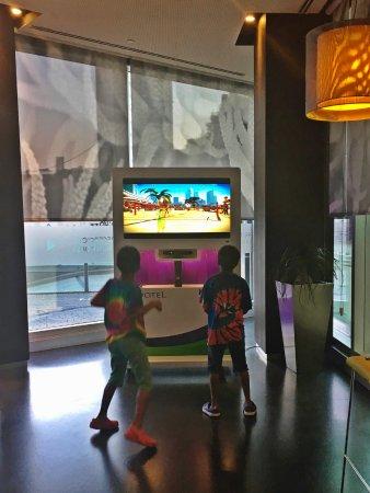 Novotel Barcelona City: Hotel lobby has games to keep kids busy