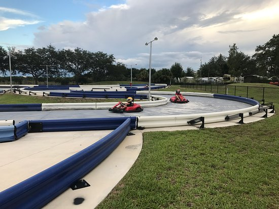 Racers tak a turn on the track based on the Sebring International Raceway
