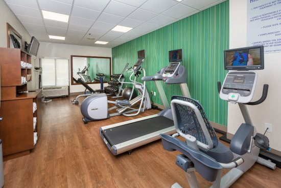Holiday Inn Express Hotel & Suites Jacksonville South: Fitness Room - Precor Equipment with Personal TVs