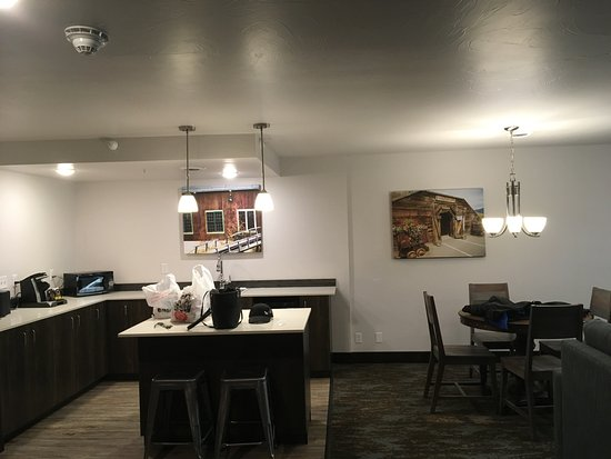 Butte, MT: The kitchen and dining area - next to a living room area with plasma tv