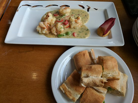Batley, UK: Lunch at Godfather! Delicious Crevettes à la Parisienne. Steak is better when medium rare.