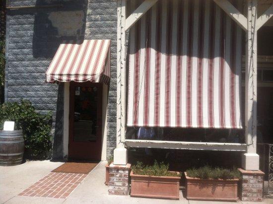 Los Olivos, CA: front facade of Sides Restaurant - tables behind awning - Ben Venuti
