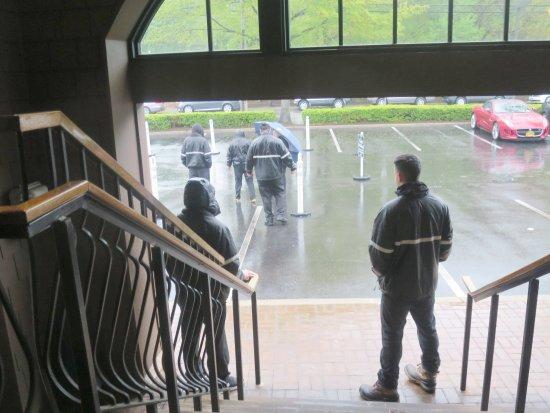 Huntington, NY: Valet parking attendants working hard even in the heavy rain