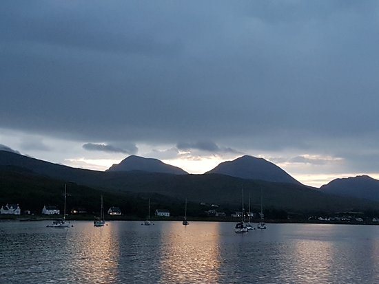 Isle of Jura, UK: View of The Paps of Jura at sunset from the pier