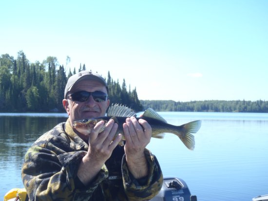 Chapleau, Canada: Hubby holding one the fish I caught.