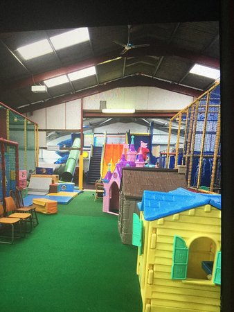 Longhope, UK: Indoor play area, green walls inside play area, overgrown go karting area, rubbish by disabled c