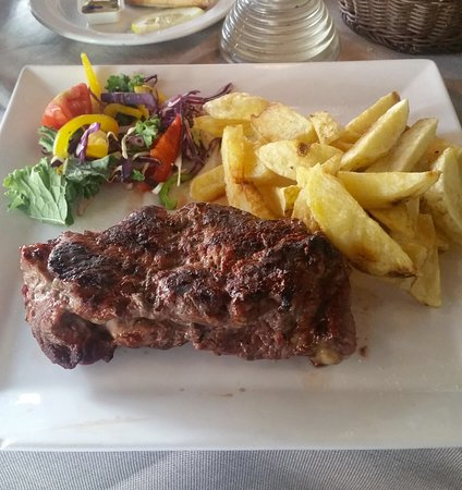 Fado Rock Steak House: large sirloin and chips