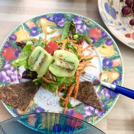 Jungle Juice Company : Fresh Broccoli + Kiwi (Half eaten!) Salad with Raw Crackers