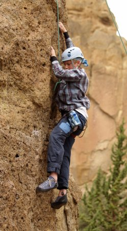 Terrebonne, OR: Checking out the next foothold on a climb at Rope-de-dope block