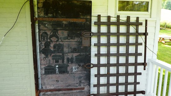 Warm Springs, VA: Wood and iron doors from the old jail. Carvings on the door were made by prisoners.