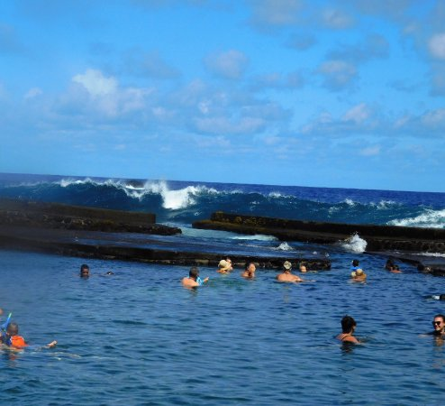 Pahoa, HI: warm pool with waves in background