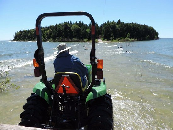 Baileys Harbor, WI: Tractor and wagon ride to the island