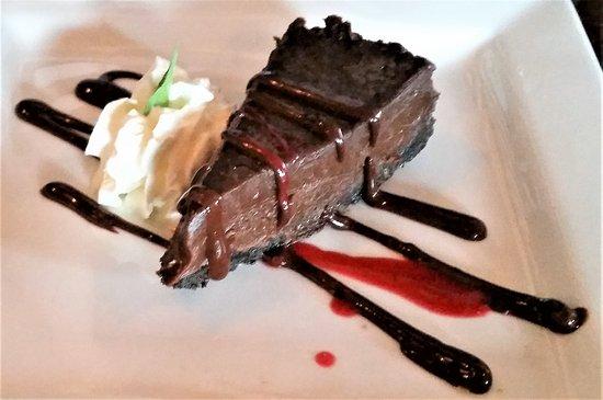 Ports Cafe: Chocolate Torte w/ chocolate ganache & raspberry coulis.