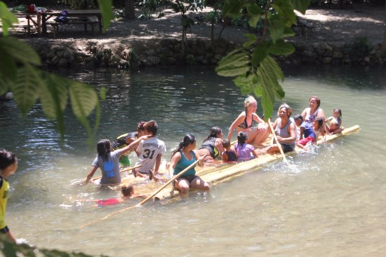 Malay, Philippines: Some foreigners joined with local tourists in a bamboo floating platform on the river.