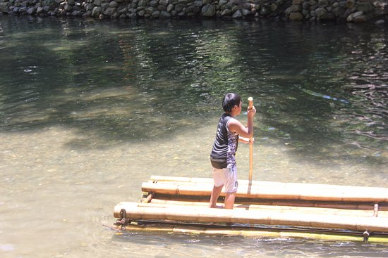 Malay, Philippines: A young boy tried himself to have his own voyage over the bamboo platform in Nabaoy River.
