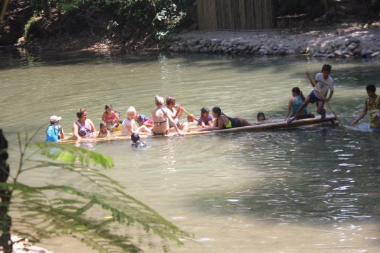 Malay, Philippines: The group of local tourists together with female guests in a floating bamboo platform.