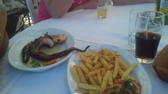 Olympiada, Grecia: Grilled octopus (french fries ordered separately- most probably frozen)