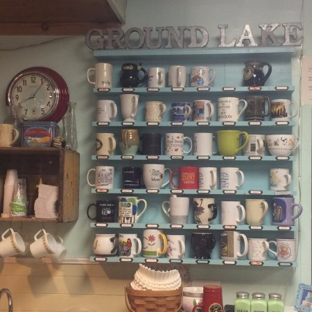 The Ground Lake coffee cup shelf where regulars leave their mugs!