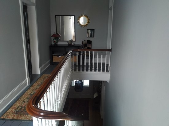 Goshen, IN: Upstairs center hall and many steps to second floor