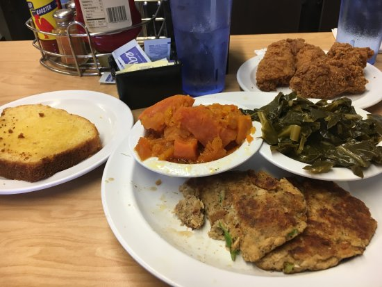 Inglewood, CA: Salmon cakes, candied yams, corn bread, collard greens and chicken drummies. YUM!