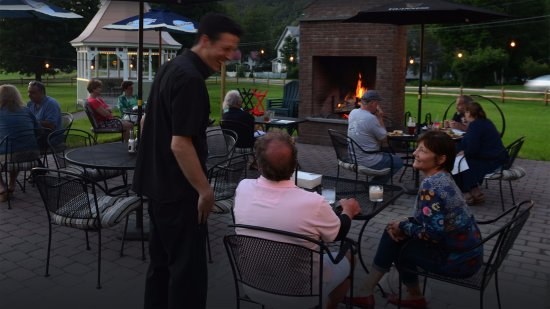 Bethel, VT: Dining on our patio with the fire roaring.
