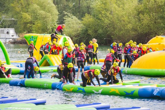 Datchet, UK: Test your ability on the inflatable assault course.