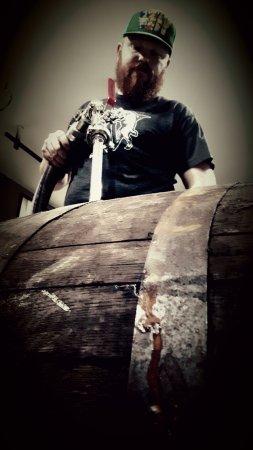 Courtenay, Canadá: Our Head Distiller filling barrels of Drunken Hive Rum