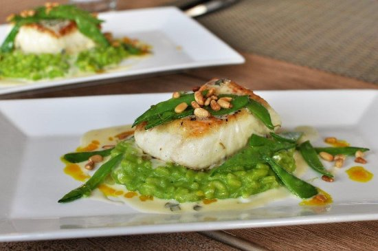 The Dunes: Grilled, line-caught swordfish with sweet basil risotto, pine nuts, snow peas, and chive buerre.