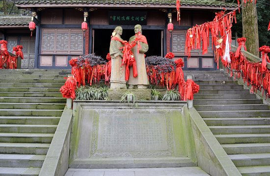 "Dujiangyan, China: The statues represent the name of the suspension bridge: ""husband and wife"" bridge."