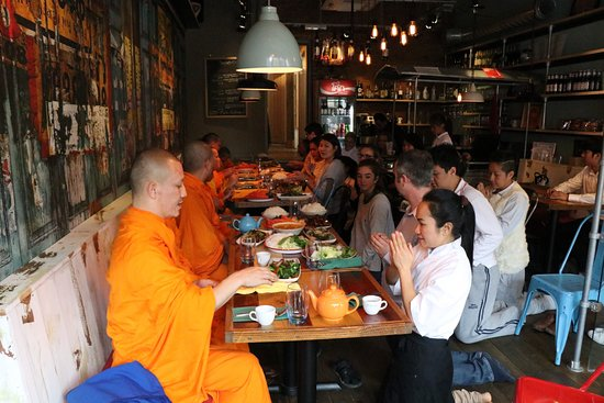Bramhall, UK: Offering food to the Buddhist Monks.