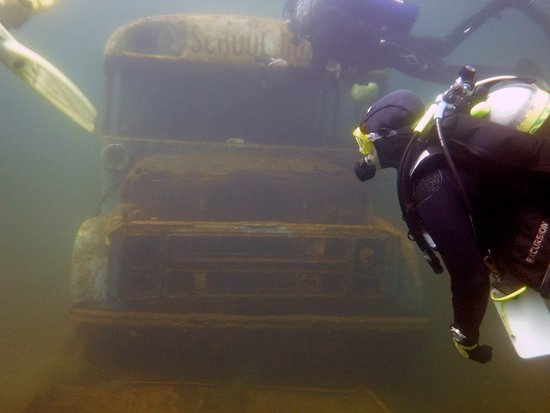 Rawlings, VA: Divers explore a submerged school bus which is open to visit inside.
