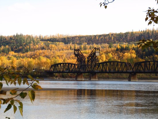 Prince George, Canada: The CN Rail Bridge crossing over the Fraser River and the October foliage