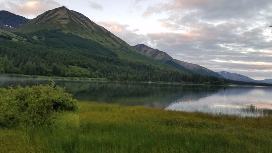 Moose Pass, AK: This is the view off my back covered porch in lake front cabin #24