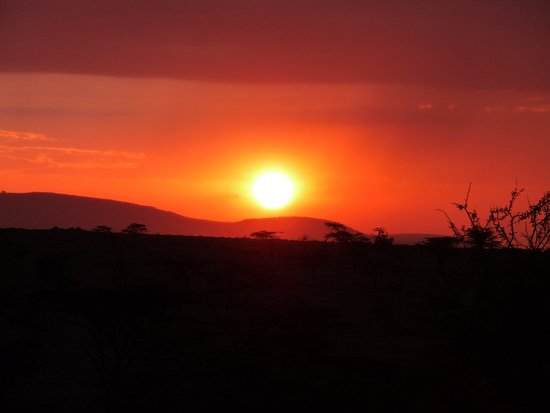 Cottar's 1920s Camp & Bush Villa: Masai Mara sun setting