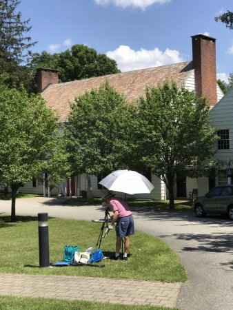 Manchester, VT: Artist working on exterior piece of Yester House.