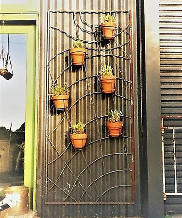 Daylesford, Australia: Wall hanging pot holder is great for small spaces [January-2017]