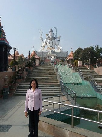 Namchi, India: The wife of the writer on the steps leading to the statue.