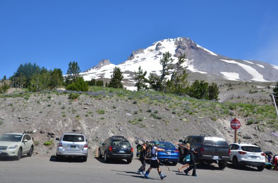 July Skiers walking from Timberline Lodge Mt Hood