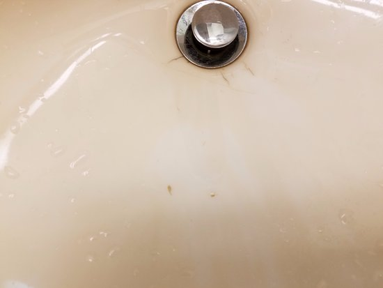 Waterloo, IL: The two dots in middle of sink - dirt in the sink that I cleaned out