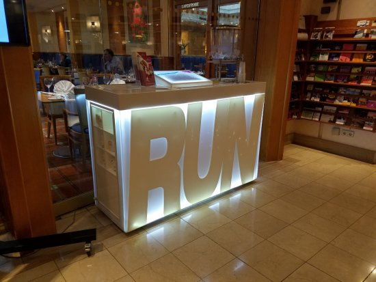 A booth catering to runners that offered a map of a 5K and 10K route