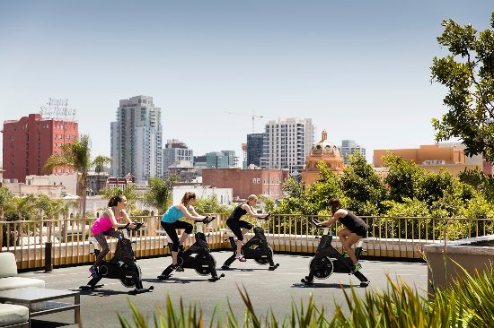 The Westgate Hotel: Rooftop Spin class with coastal breeze and views of downtown.