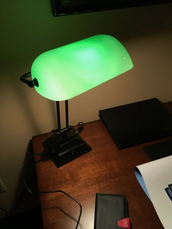 This is the desk lamp. Fun for a stage set but totally impractical for business. Small student d