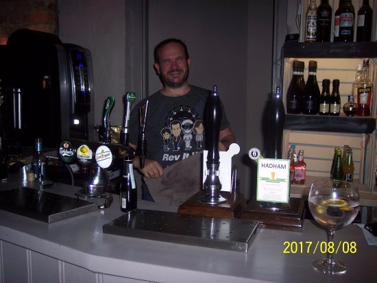 Little Hallingbury, UK: The owner behind the bar