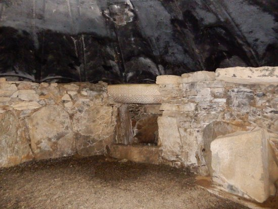 County Meath, Ireland: Inside Fourknocks Burial Tomb. Stone carvings on display.