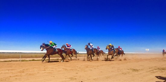 Bourke, Australia: Awesome, huge, horse racing event in the NSW Outback.  Attended by 4000 funny people who travel