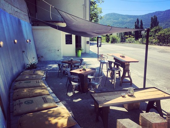 Puivert, France: BDQ Terrasse - tables made from up-cycled pied industriel. Cushions crafted from old coffee sack
