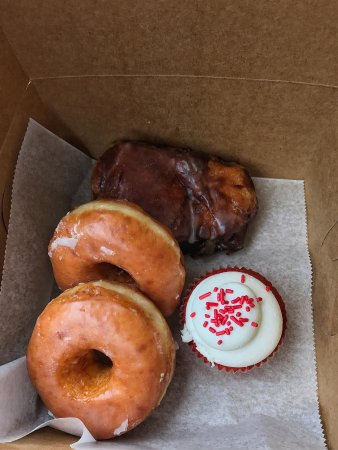 Petersburg, VA: Donuts, peach fritter, and red velvet cupcake.