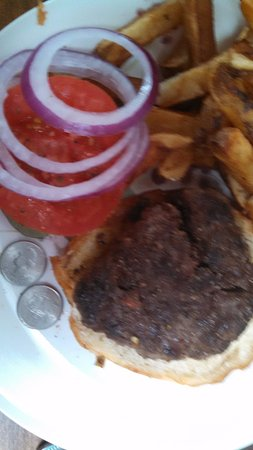 Corner Burger: The quarters on the plate show you how small my $8.00 burnt burger was